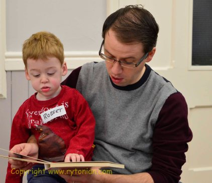 Dad and son have a quiet read before everyone else arrives