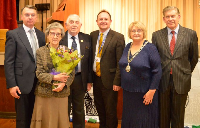 Vice-President Jennie Marshall recives 100th birthday presentation. From left to right, Darren Johnstone, Jennie, Howard Taylor, Steven Roberts, Deputy Mayor of Gateshead Councillor Pauline Dillon, and Festival Vice-president John Robinson.