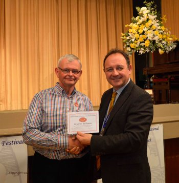 Graeme Williams receiving his long service award from Steven Roberts (40 years)